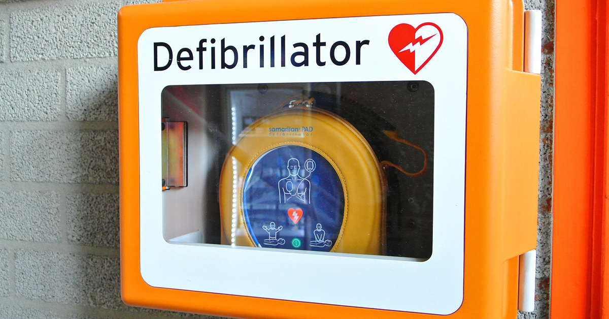 Image of an AED defibrillator in a wall case